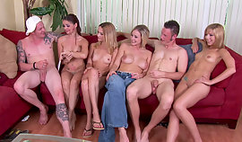 Lustful maidens with considerable bumpers are sitting with inviting guys